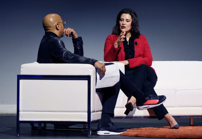 Gov. Gretchen Whitmer makes a point about the roads and other topics during her one-on-one conversation with Dennis Archer Jr. Thursday at the Detroit Policy Conference.