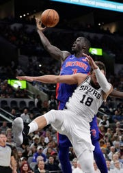 Detroit Pistons forward Thon Maker (7) reaches over San Antonio Spurs guard Marco Belinelli (18) for a rebound during the first half Wednesday.