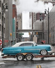 Todd Gambino of Lincoln Park's 1953 Ford Sunliner Convertible, chopped 3 inches with a 350 Chevy engine, rolls down Fort Street and into Cobo Center, preparing for the 67th Annual Autorama.