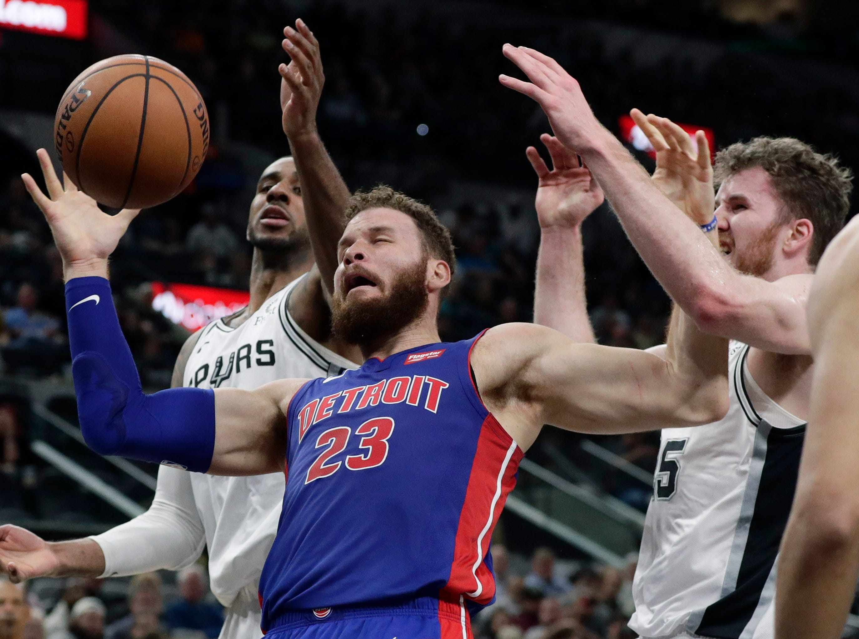 San Antonio Spurs center LaMarcus Aldridge, left, causes Detroit Pistons forward Blake Griffin (23) to lose control of the ball during the first half.