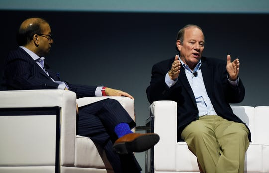 Detroit Mayor Mike Duggan, right, makes a point during the discussion about the 2020 census campaign that will start April 1 in preparation for next year's count. Sandy Baruah, president and CEO of the Detroit Regional Chamber, left, was the moderator.