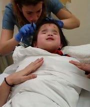 Evie, 8, prepping for testing at C.S. Mott Children's Hospital.