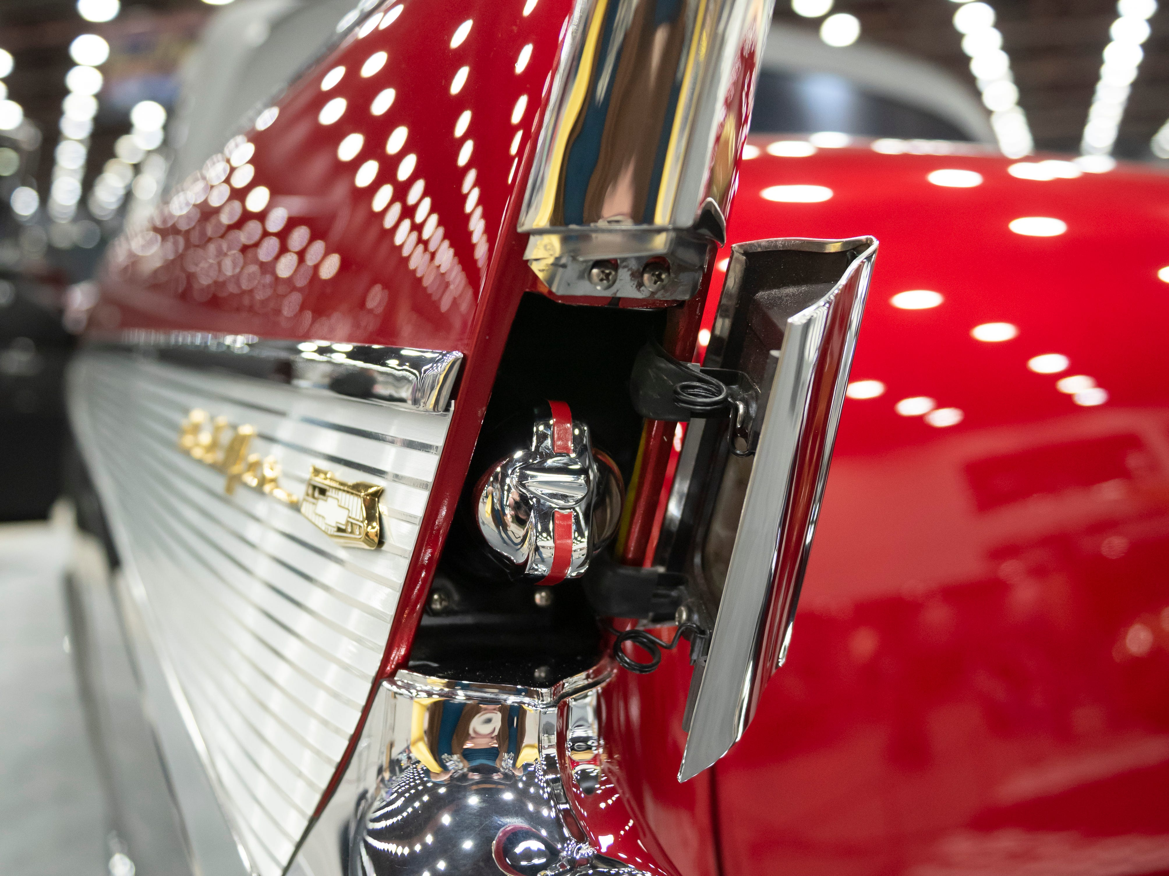The rear fin and gas cap of a 1957 Chevy Bel Air convertible owned by Philip and Patty Wiegand, of Richmond.