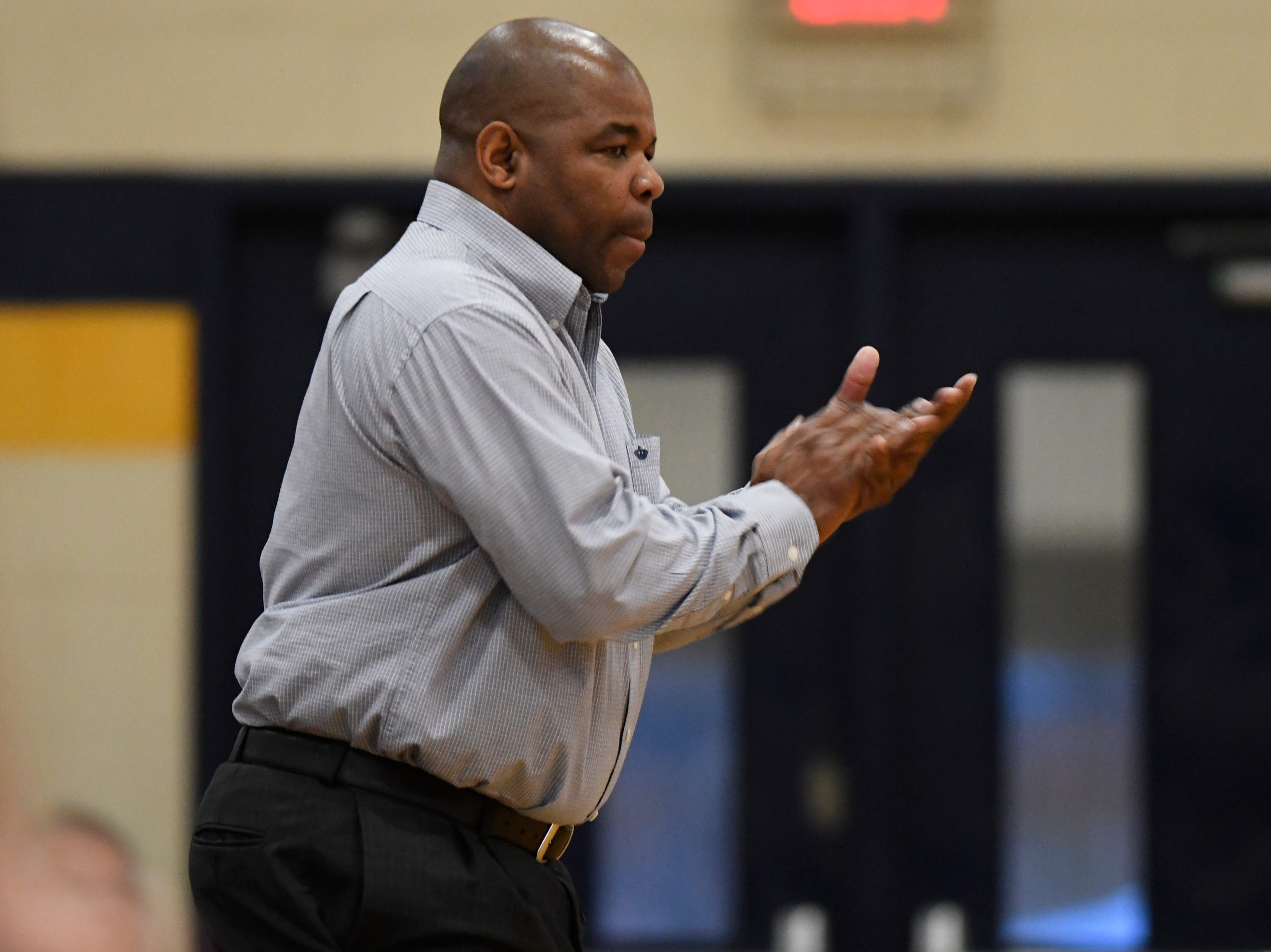 Westland John Glenn head coach Rod Watts cheers on his team during the third quarter.