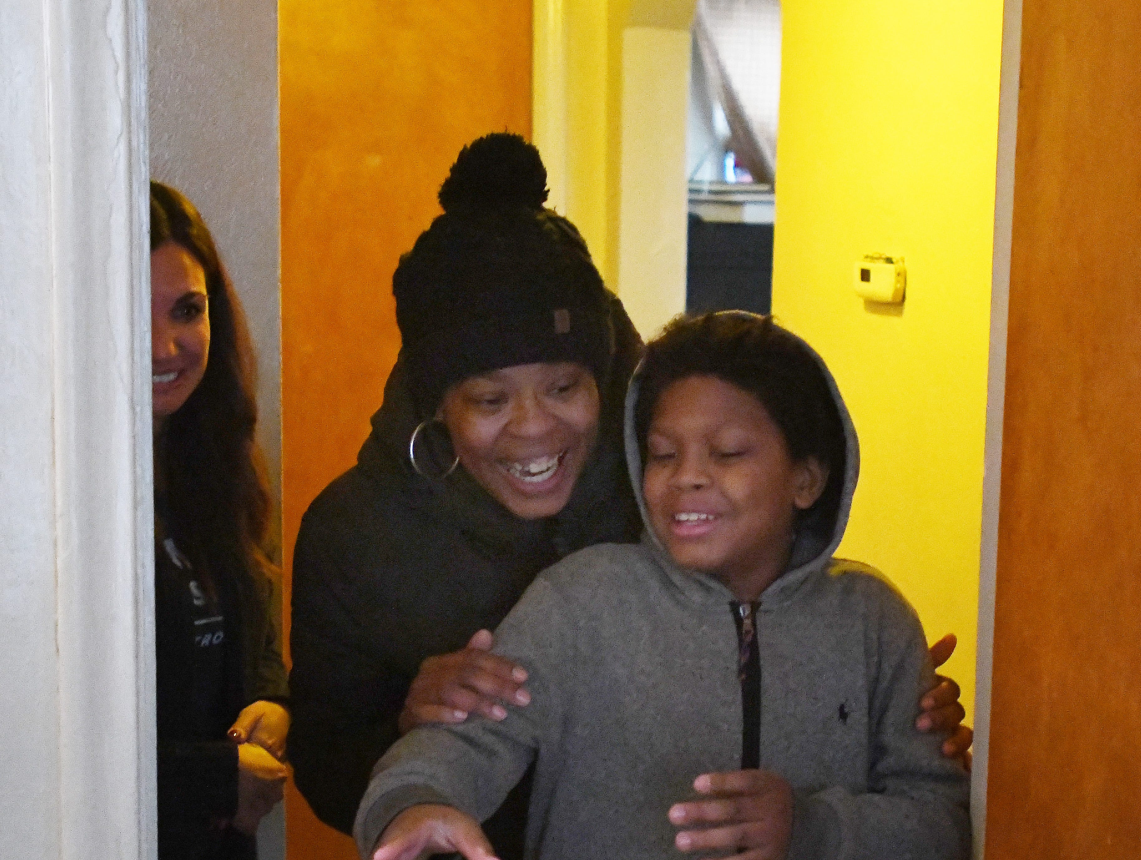 Jamiliah Powers-McCoy and her son Jai'Vonte, 12, enter his newly furnished room to see what the Humble Design team did to jazz it up.