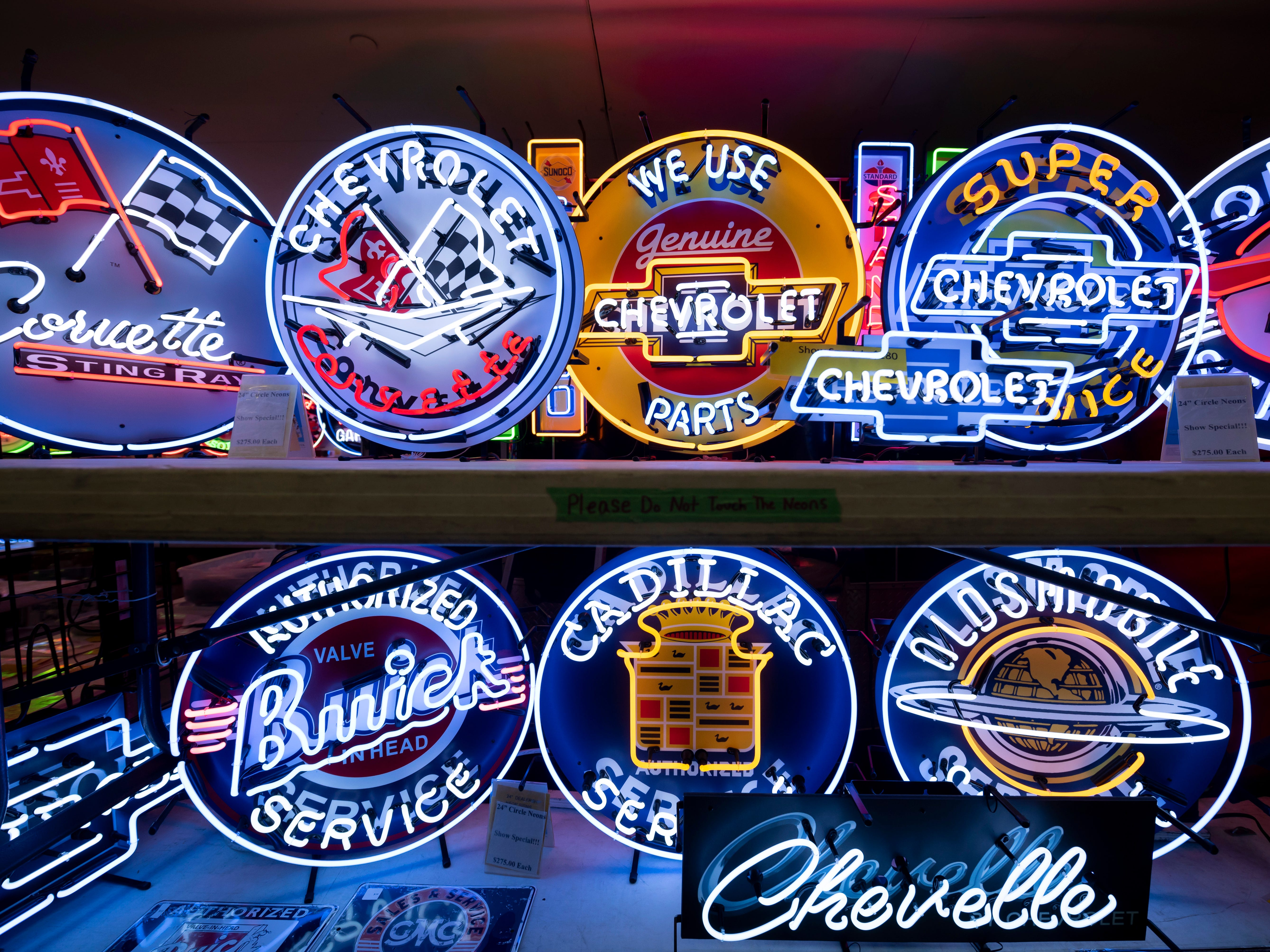 Neon signs are among the items for sale at Detroit Autorama.
