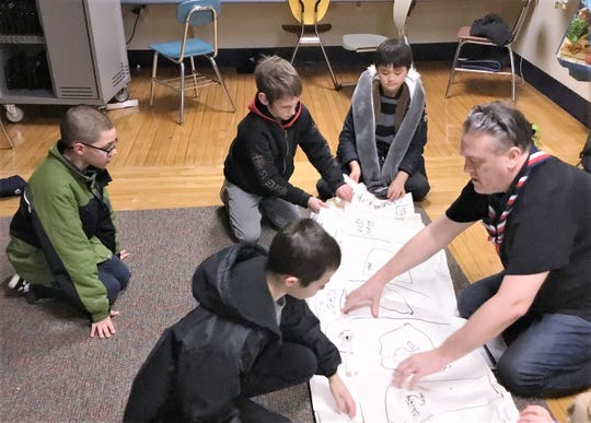 A group of Cub Scouts learns about mapping as part of the Elmira City School District's community schools initiative.