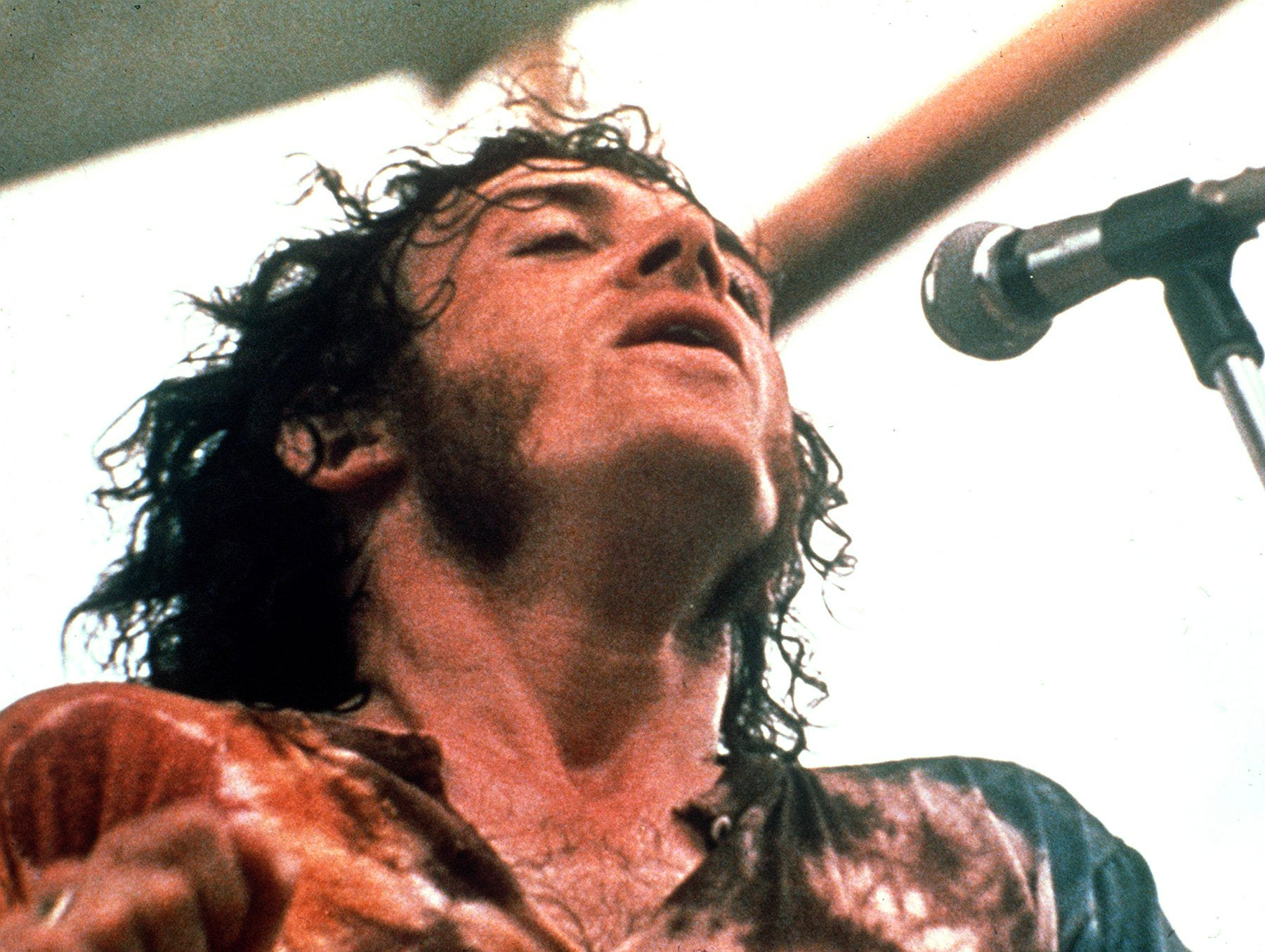Joe Cocker performs during the Woodstock Music Festival in Bethel, N.Y., in this Aug. 1969 file photo.