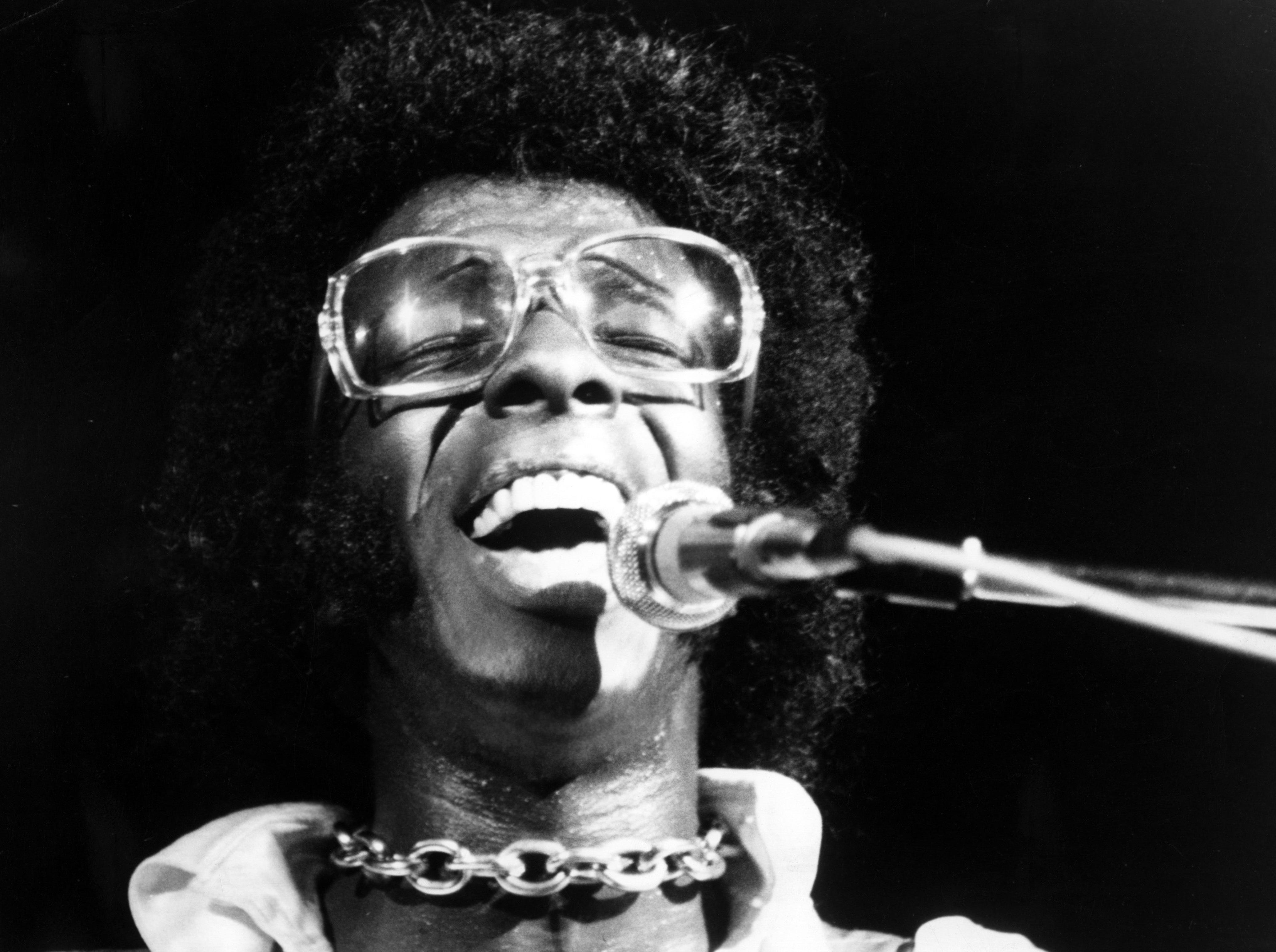 "Sly Stone of the psychedelic soul group ""Sly And The Family Stone"" performs at the Woodstock Festival on August 17, 1969 in Bethel, New York."