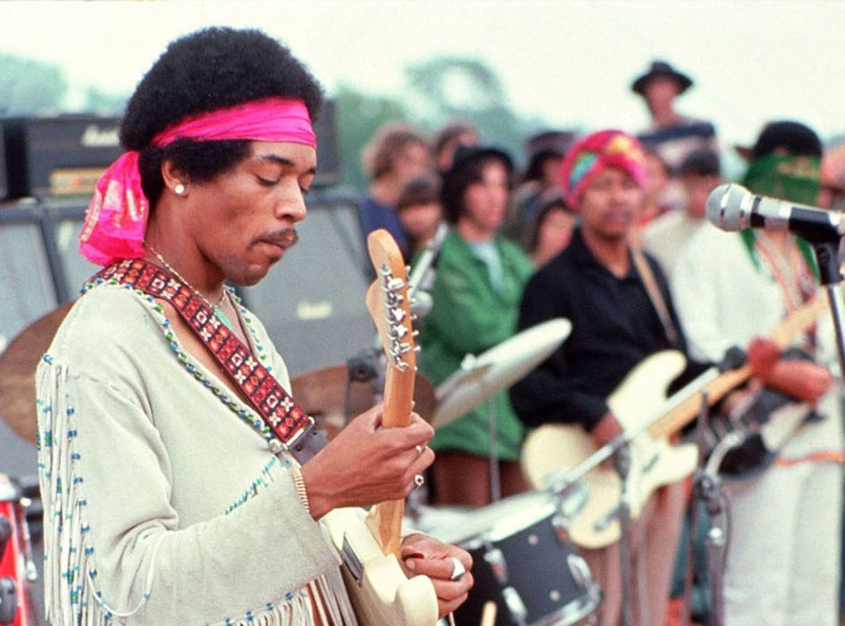 This handout photo by Henry Diltz shows musician Jimi Hendrix at the original Woodstock festival in Bethel, New York in August 1969.