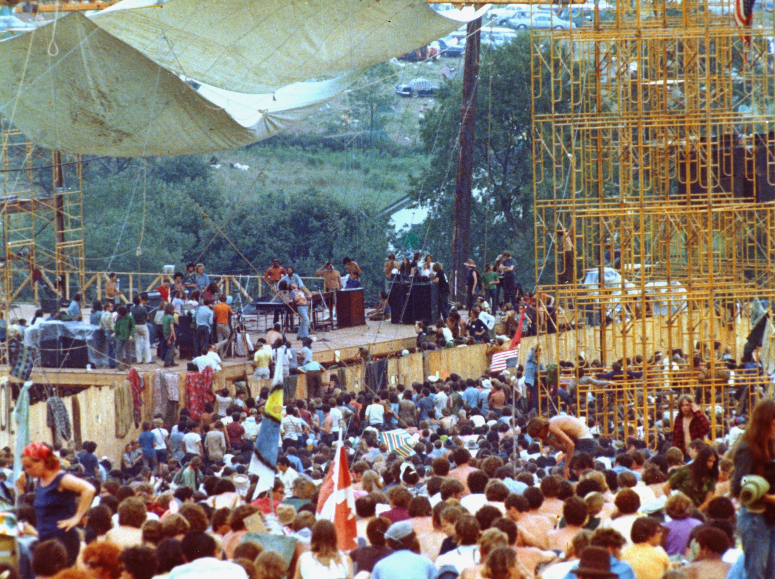 DO NOT USE THIS PHOTO, IT'S OUT OF OUR PLAN AND WE HAVE TO PAY FOR IT. Concert goers surround the stage as Joe Cocker performs at the Woodstock Music and Arts Festival in Bethel, N.Y. on Aug. 17, 1969.