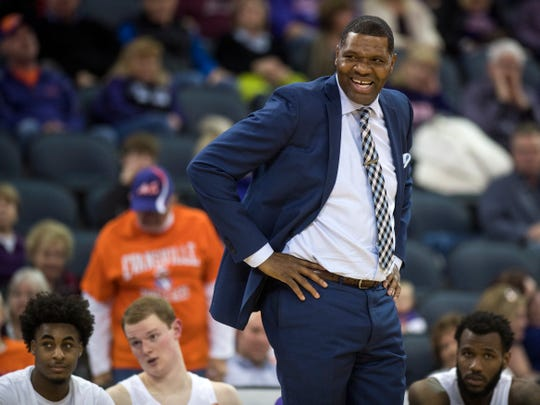 University of Evansville Head Coach Walter McCarty laughs after disagreeing with a foul call in the second half against the Southern Illinois University Salukis at Ford Center in Evansville, Ind., Wednesday, Feb. 27, 2019. The Salukis defeated the Purple Aces, 98-91.