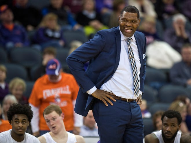 University of Evansville Head Coach Walter McCarty laughs after disagreeing with a foul call in the second half against the Southern Illinois University Salukis at Ford Center in Evansville, Ind., Wednesday, Feb. 27, 2019.