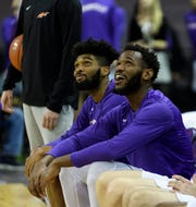 University of Evansville's K.J. Riley (33) and John Hall (35) react to a video honoring the senior players during senior night \against the Southern Illinois University Salukis at Ford Center in Evansville, Ind., Wednesday, Feb. 27, 2019. The Salukis defeated the Purple Aces, 98-91.
