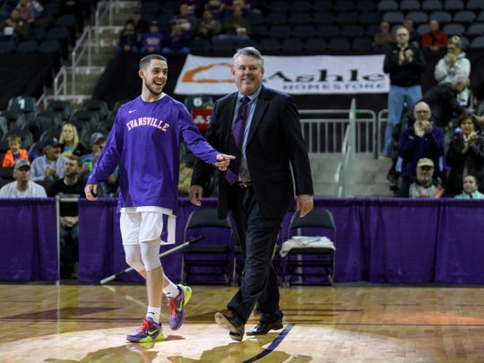 University of Evansville's Shea Feehan (21) walks onto the court with his father as he is honored on senior night before taking on the Southern Illinois University Salukis at Ford Center in Evansville, Ind., Wednesday, Feb. 27, 2019. The Salukis defeated the Purple Aces, 98-91.