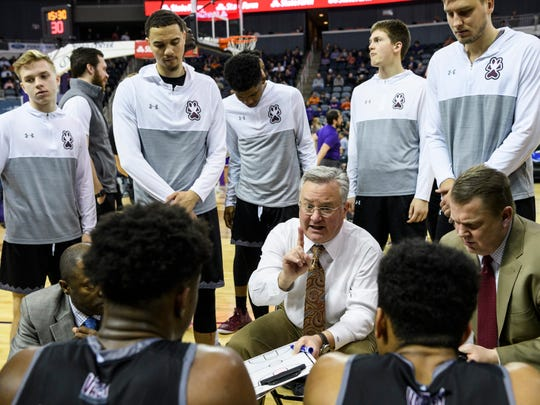 Southern Illinois University Head Coach Barry Hinson, center, talks to his team during a timeout in the second half against the University of Evansville Purple Aces at Ford Center in Evansville, Ind., Wednesday, Feb. 27, 2019. The Salukis defeated the Purple Aces, 98-91.