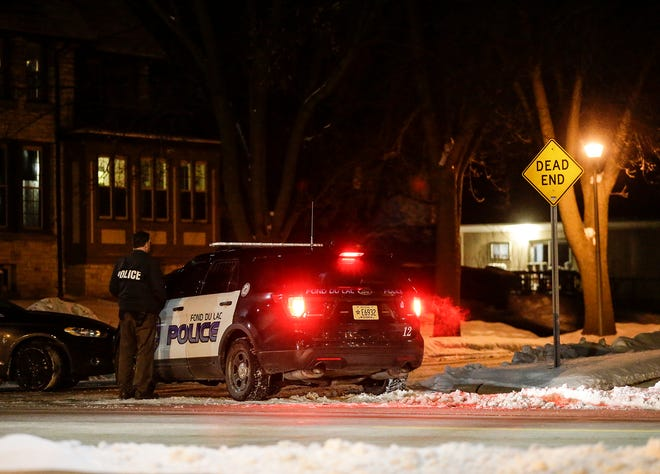A Fond du Lac police officer sets up as part of a perimeter Wednesday, February 27, 2019 at Sophia and Division streets in Fond du Lac, Wis., while police negotiate with a person during an incident in the area.