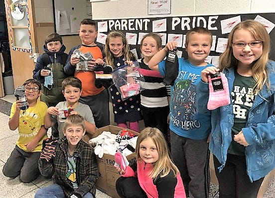 Third graders at RC Waters Elementary collected socks for others as one of their service project.