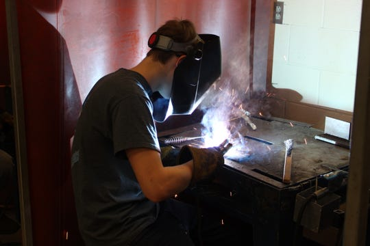 Colin Zelms, 17, from Lakota High School, practices his welding skills Thursday at Vanguard Tech Center in Fremont. Vanguard and Terra State Community College announced a pathway partnership on eight programs, including welding, in July 2018.