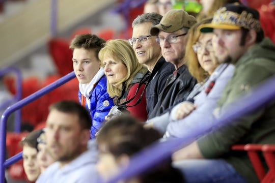 Janice and Chris Clemens of Ashwaubenon, second and third from left, watch a Green Bay Gamblers game at the Resch Center. As a housing family for players, they also take photos at home games to share with the players' families back home.