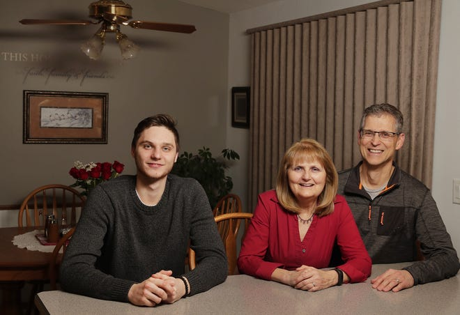 Janice and Chris Clemens of Ashwaubenon sit in their dining room with Green Bay Gamblers goalie Maksim Zhukov from Kaliningrad, Russia. Zhukov lives with the Clemens, who have hosted Gamblers players for 12 seasons.