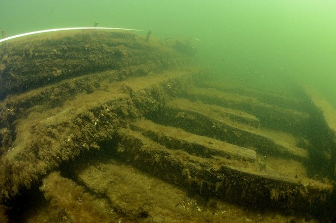 Underwater photo of barge sunk in 1921 during a storm. The Advance lies in about 8 feet of water off of the Sand Bay Peninsula, town of Nasewaupee, Door County.