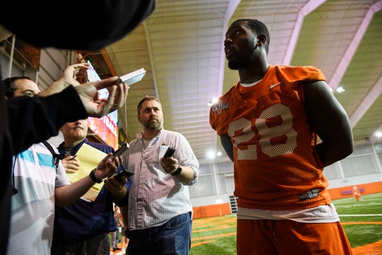 Clemson running back Tavien Feaster (28) speaks with members of the press after practice at the Allen Reeves Football Complex on Wednesday, Feb. 27, 2019.