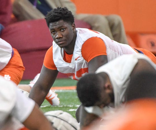 Clemson defensive lineman Ruke Orhorhoro(33) stretches during the first practice at the Clemson Indoor Practice Facility in Clemson Wednesday, February 27, 2019.