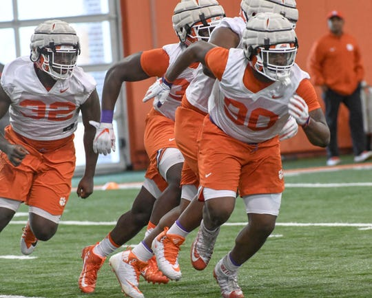 Clemson defensive lineman Etinosa Reuben (32) and Clemson defensive tackle Darnell Jefferies (90) run during the first practice at the Clemson Indoor Practice Facility in Clemson Wednesday, February 27, 2019.