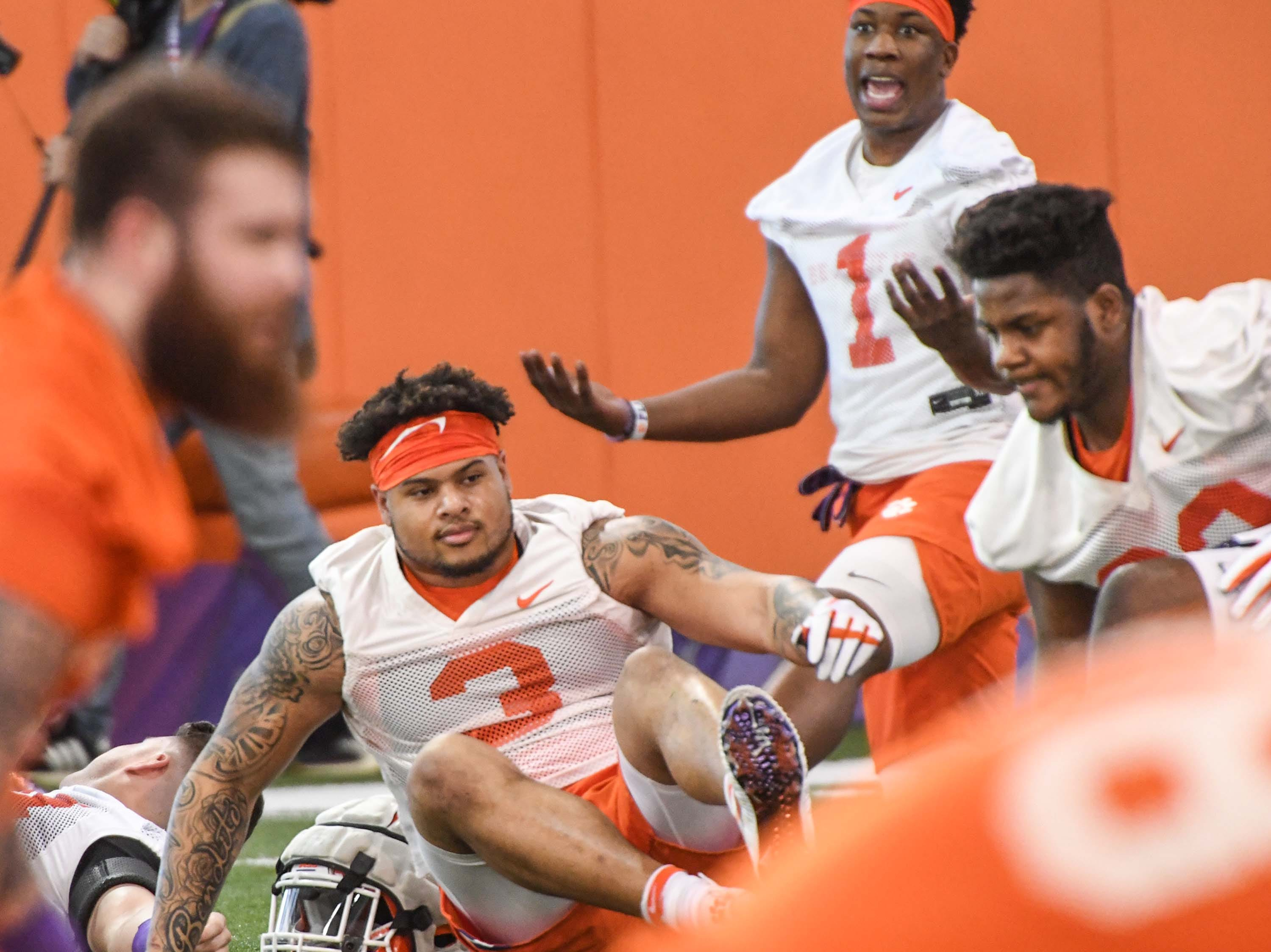 Clemson defensive end K.J. Henry (1) smiles with Clemson defensive lineman Xavier Thomas (3) during the first practice at the Clemson Indoor Practice Facility in Clemson Wednesday, February 27, 2019.