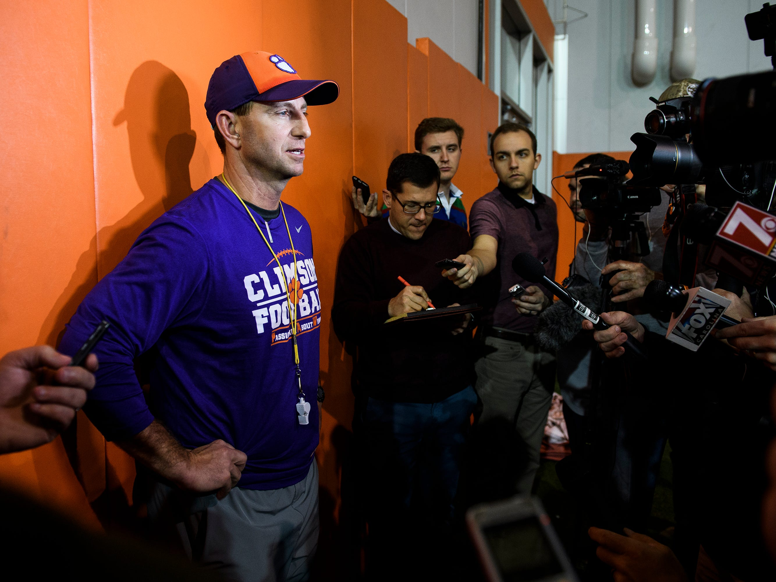 Clemson head coach Dabo Swinney speaks with members of the press after practice at the Allen Reeves Football Complex on Wednesday, Feb. 27, 2019.