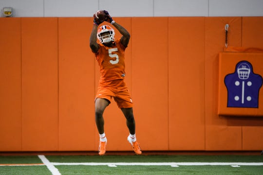 Clemson wide receiver Tee Higgins (5) catches the ball during practice at the Allen Reeves Football Complex on Wednesday, Feb. 27, 2019.