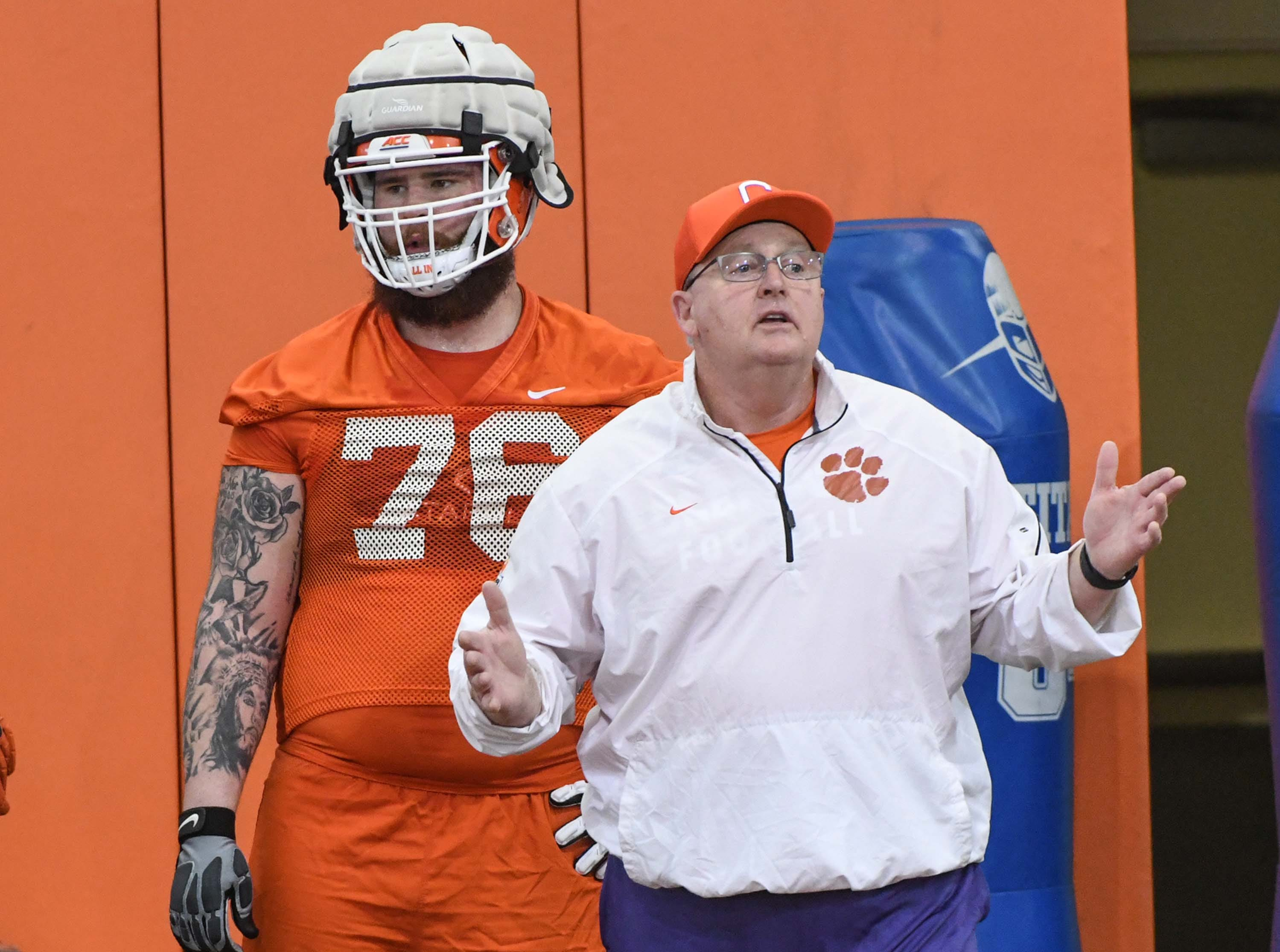 Clemson offensive lineman Sean Pollard (76) stands near coach Robbie Caldwell during the first practice at the Clemson Indoor Practice Facility in Clemson Wednesday, February 27, 2019.
