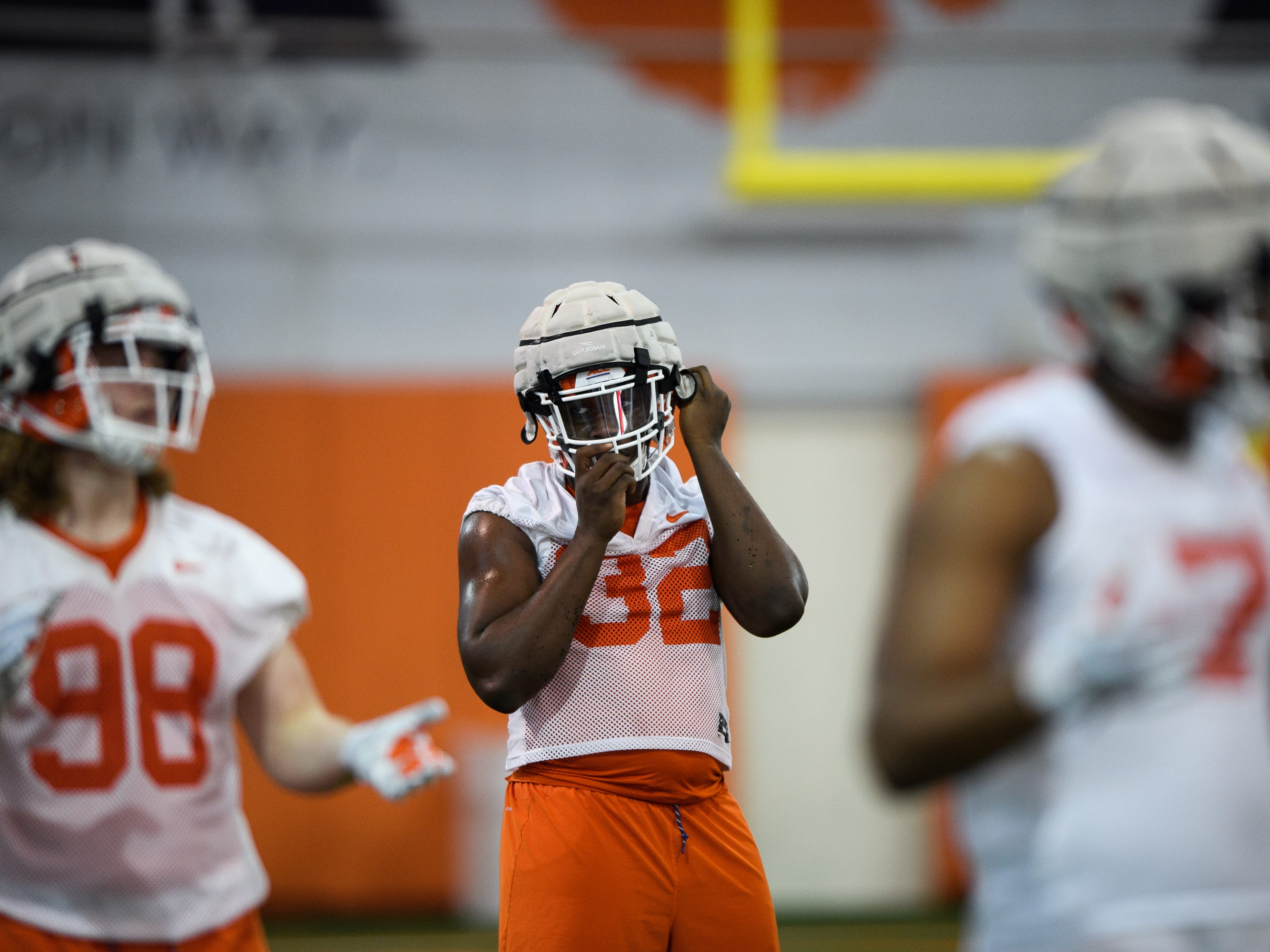 Clemson defensive lineman Etinosa Reuben (32) puts on his helmet during practice at the Allen Reeves Football Complex on Wednesday, Feb. 27, 2019.