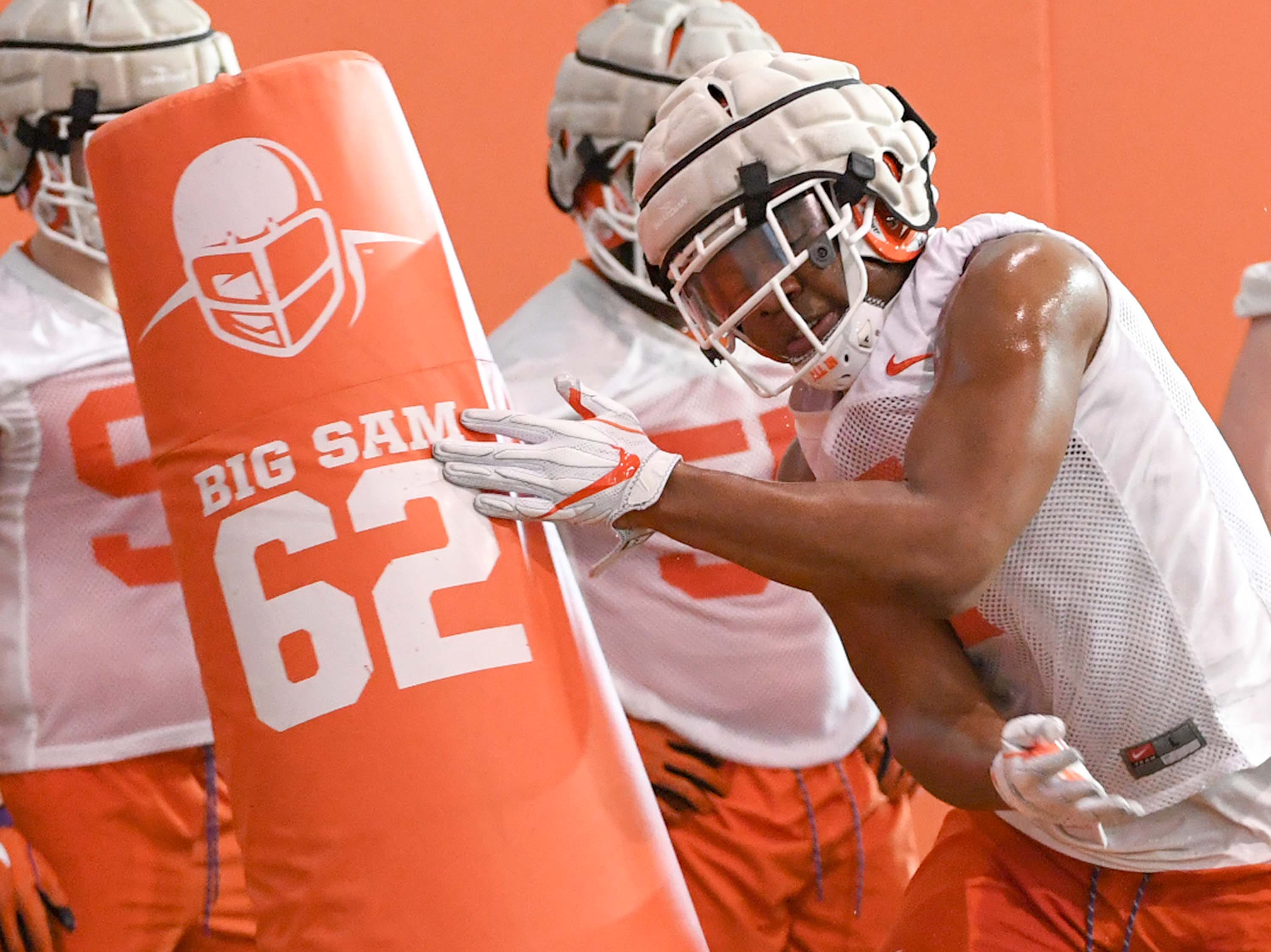 Clemson defensive end Justin Mascoll(7) hits a blocking dummy during the first practice at the Clemson Indoor Practice Facility in Clemson Wednesday, February 27, 2019.