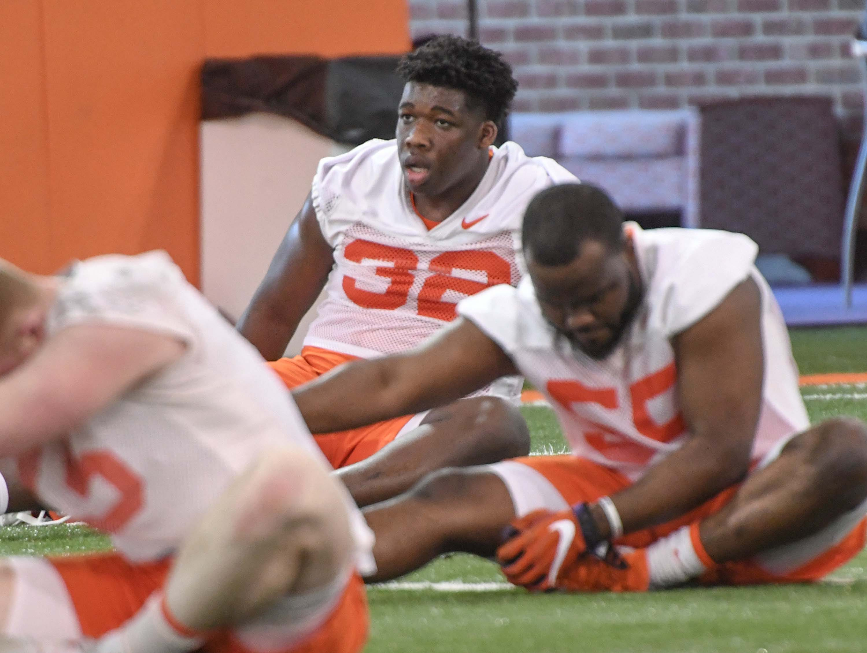 Clemson defensive lineman Etinosa Reuben (32) stretches during the first practice at the Clemson Indoor Practice Facility in Clemson Wednesday, February 27, 2019.