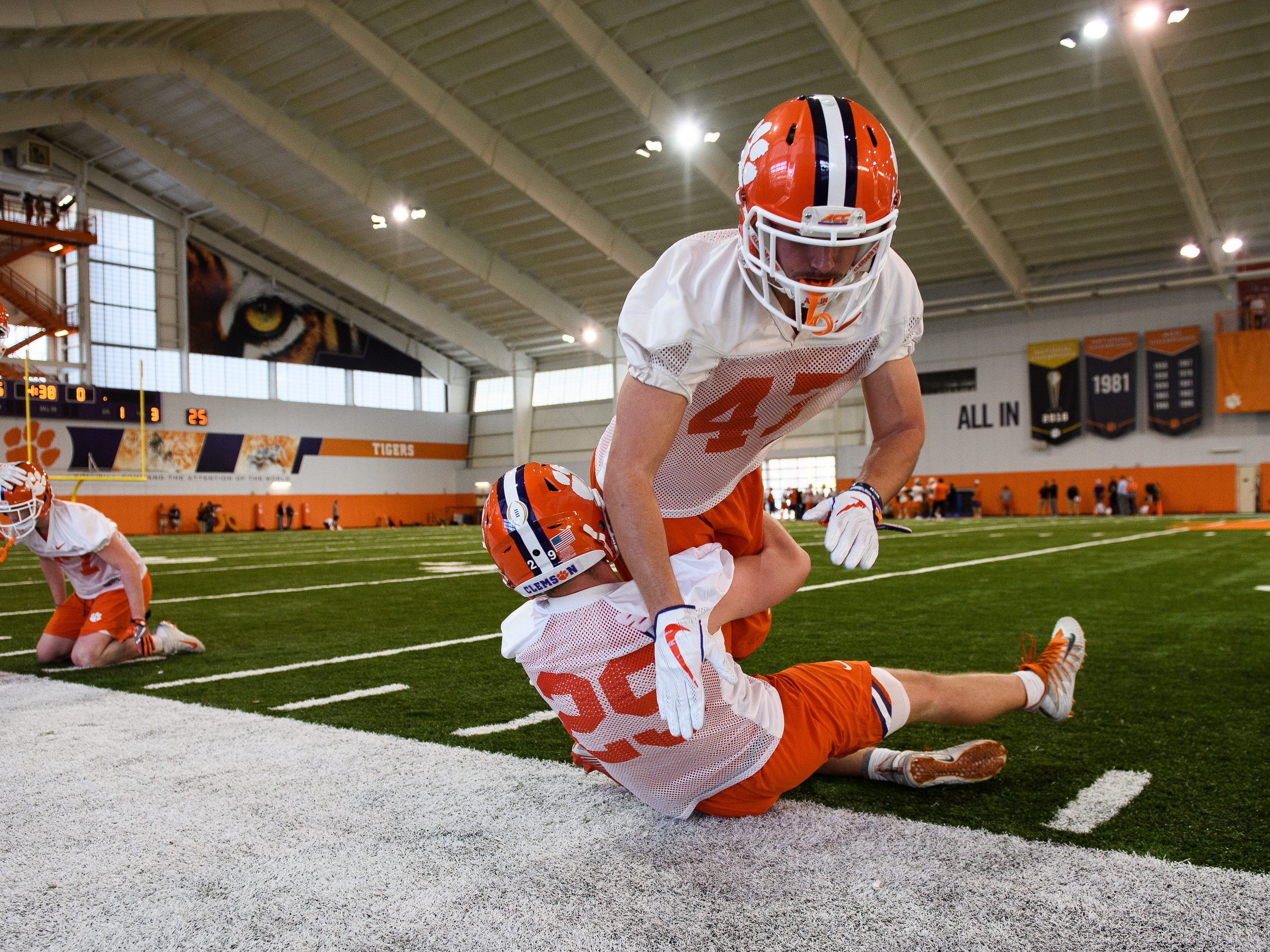Clemson tight end J.C. Chalk (25) and linebacker James Skalski (47) go through drills during practice at the Allen Reeves Football Complex on Wednesday, Feb. 27, 2019.