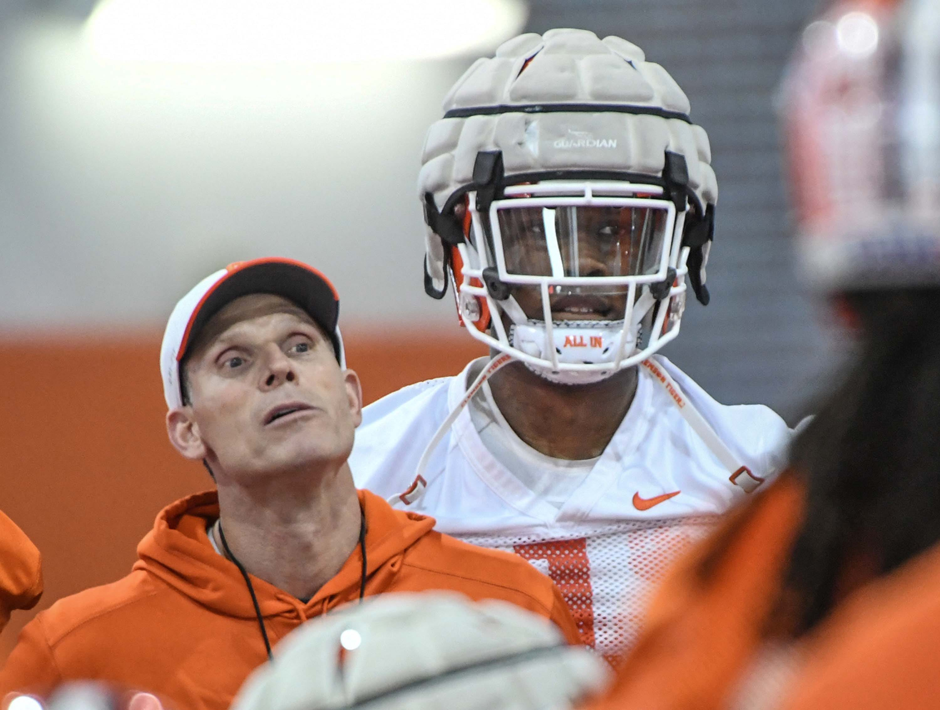 Clemson defensive coordinator Brent Venables and Clemson defensive end K.J. Henry (1) during the first practice at the Clemson Indoor Practice Facility in Clemson Wednesday, February 27, 2019.