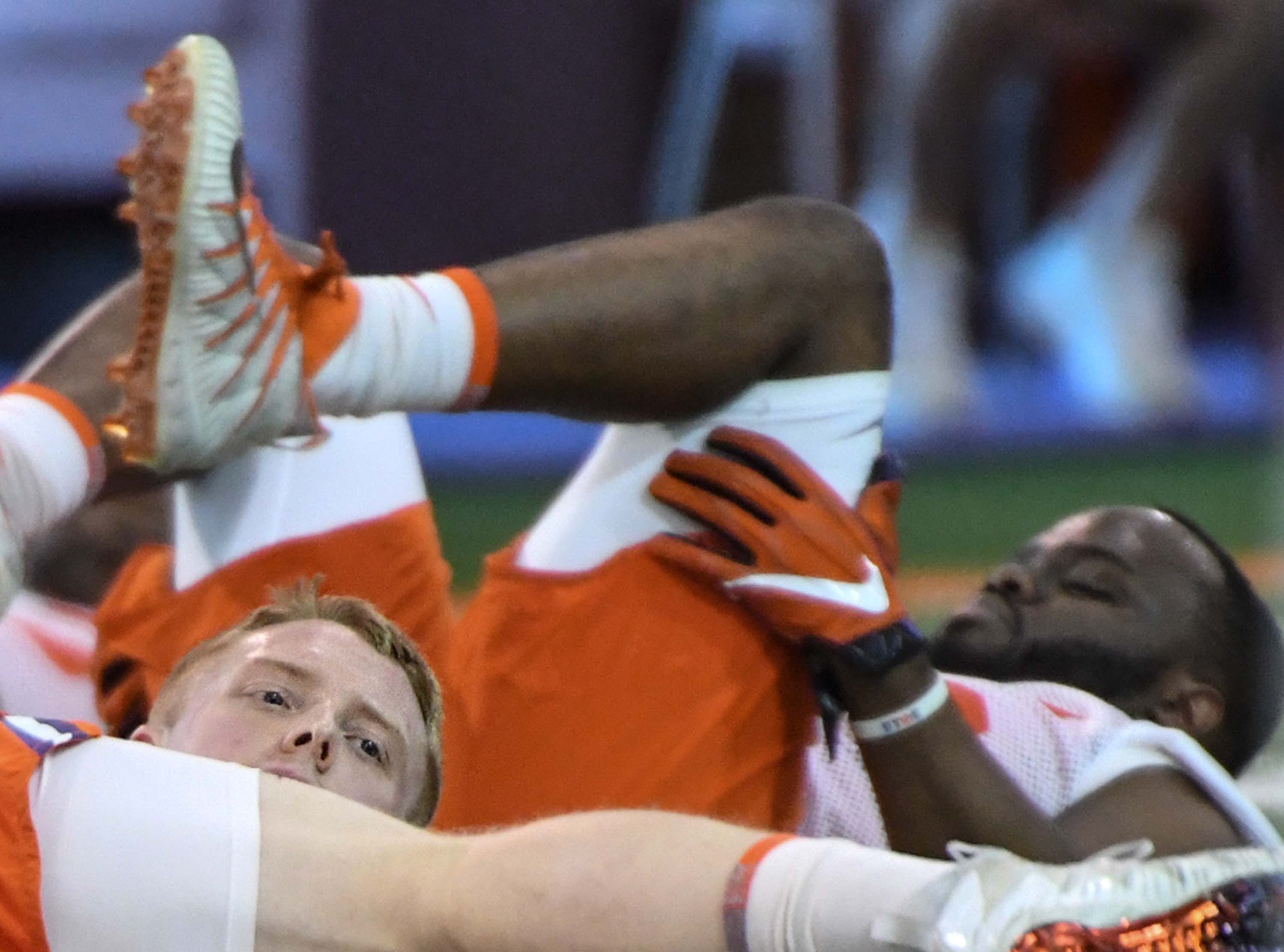 Clemson linebacker Jake Venables (15) stretches during the first practice at the Clemson Indoor Practice Facility in Clemson Wednesday, February 27, 2019.