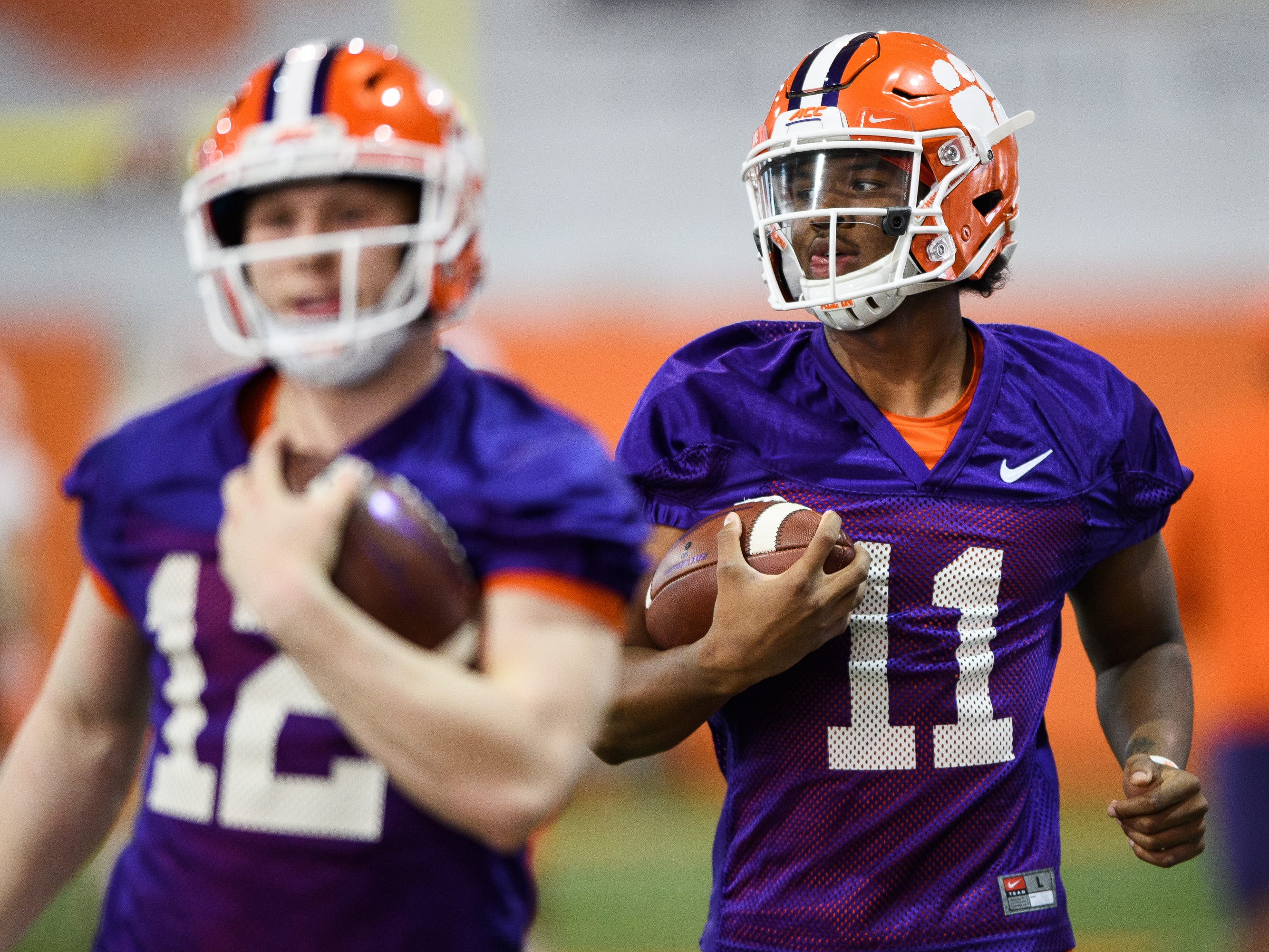 Clemson quarterback Taisun Phommachanh (11) walks with quarterback Ben Batson (12) during practice at the Allen Reeves Football Complex on Wednesday, Feb. 27, 2019.