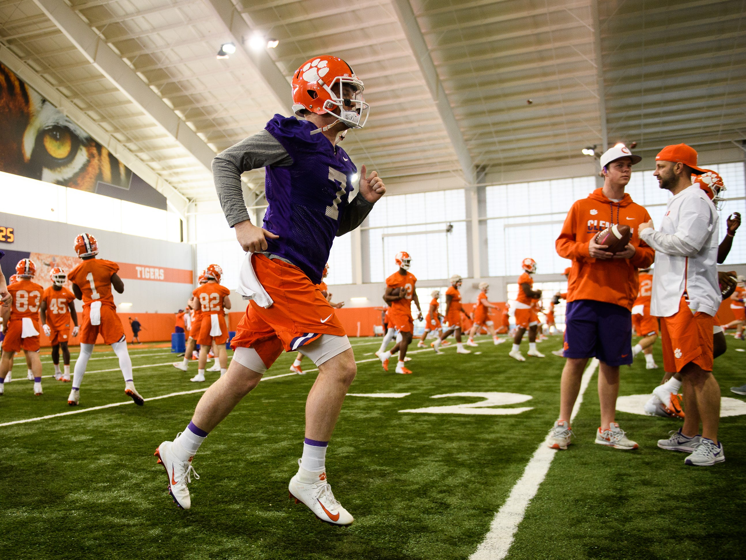 Clemson quarterback Chase Brice (7) runs during practice at the Allen Reeves Football Complex on Wednesday, Feb. 27, 2019.