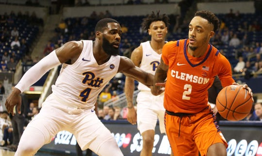 Clemson guard Marcquise Reed (2) drives to the basket against Pittsburgh guard Jared Wilson-Frame (4) during the second half Wednesday night in Pittsburgh, Pa.