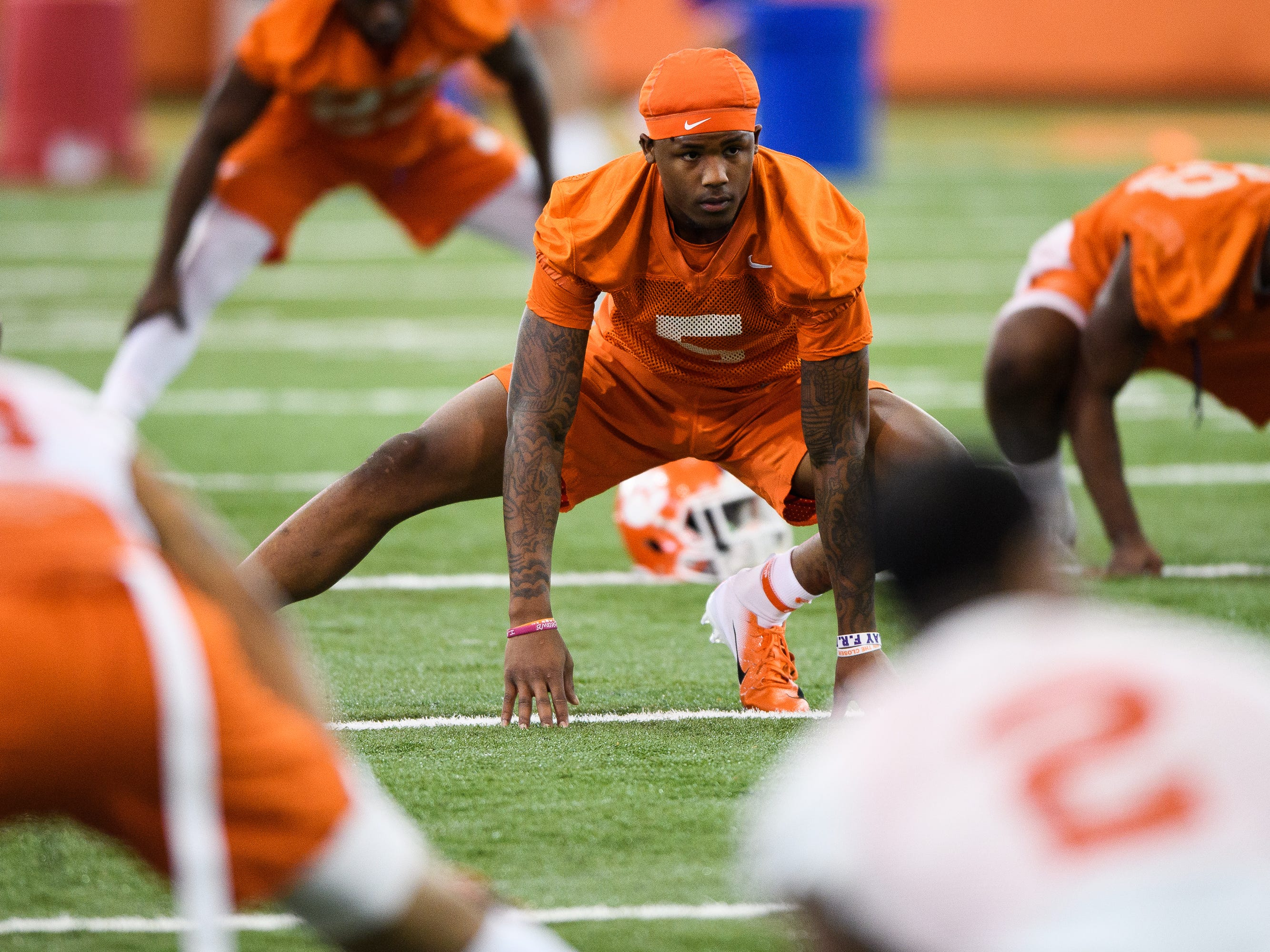 Clemson linebacker Shaq Smith (5) stretches during practice at the Allen Reeves Football Complex on Wednesday, Feb. 27, 2019.