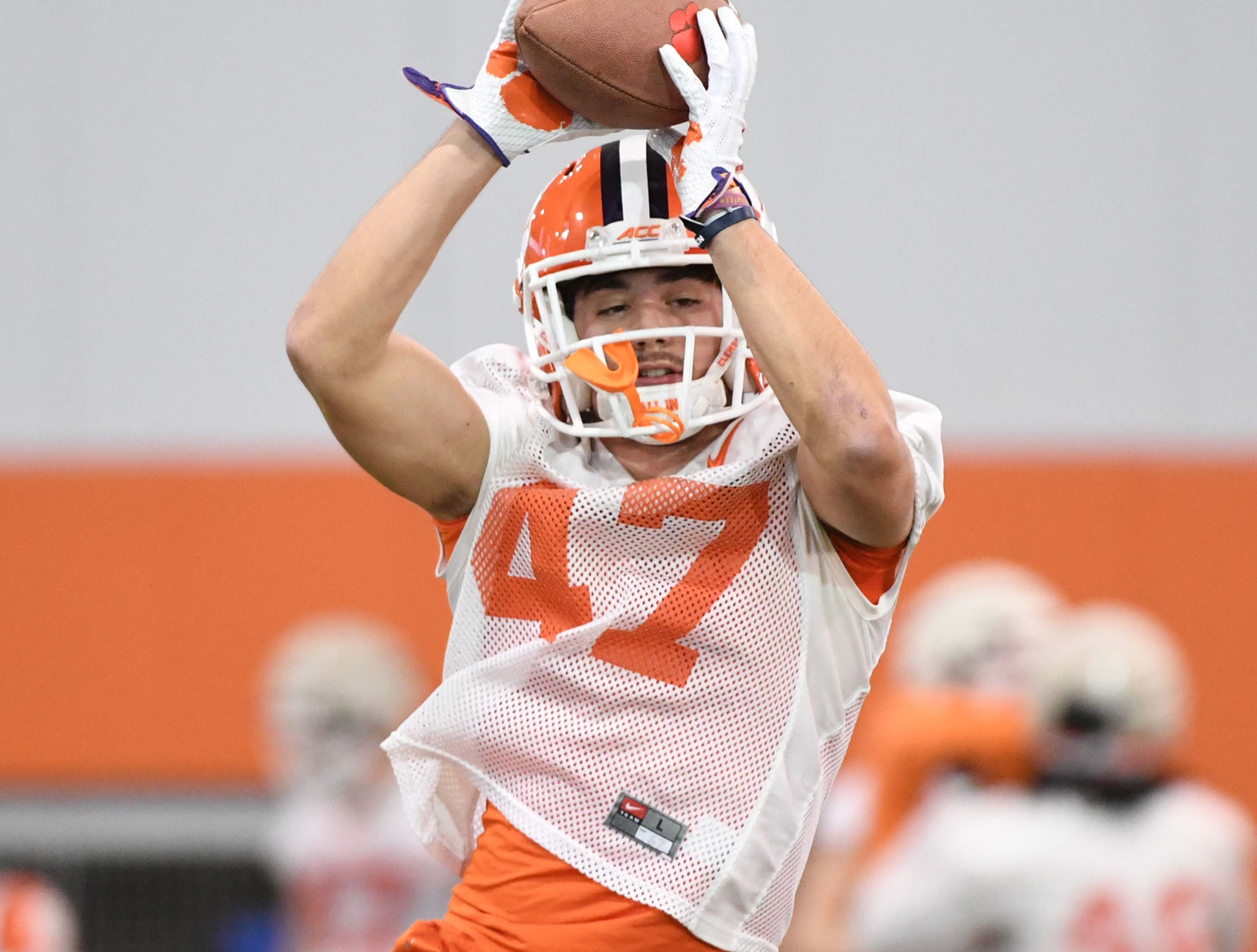 Clemson linebacker James Skalski (47) catches a ball during the first practice at the Clemson Indoor Practice Facility in Clemson Wednesday, February 27, 2019.