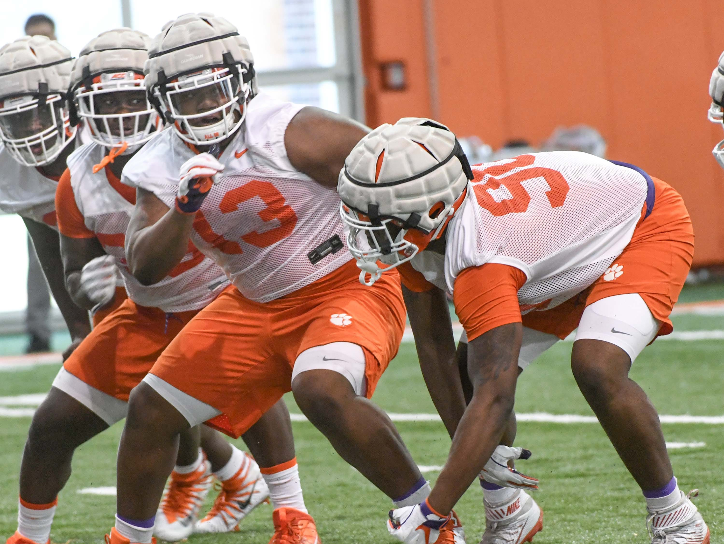 Clemson defensive lineman Tyler Davis (13) and Clemson defensive tackle Darnell Jefferies (90) during the first practice at the Clemson Indoor Practice Facility in Clemson Wednesday, February 27, 2019.