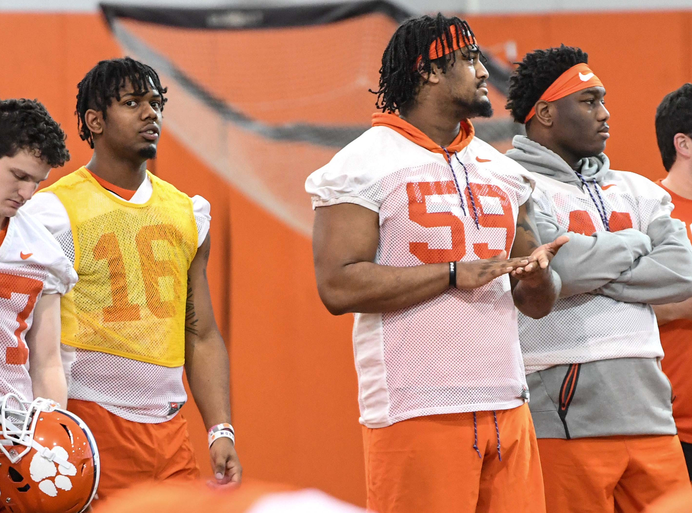 Clemson defensive back Ray Thornton III (16), defensive lineman Jordan Williams (59) and defensive tackle Nyles Pinckney (44) watch practice during the first practice at the Clemson Indoor Practice Facility in Clemson Wednesday, February 27, 2019.