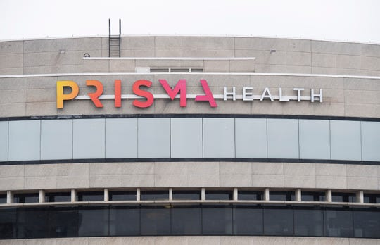 The new sign for Prisma Health facing East Court Street on the building located at 300 East McBee Avenue in Greenville Thursday, Feb. 28, 2019.