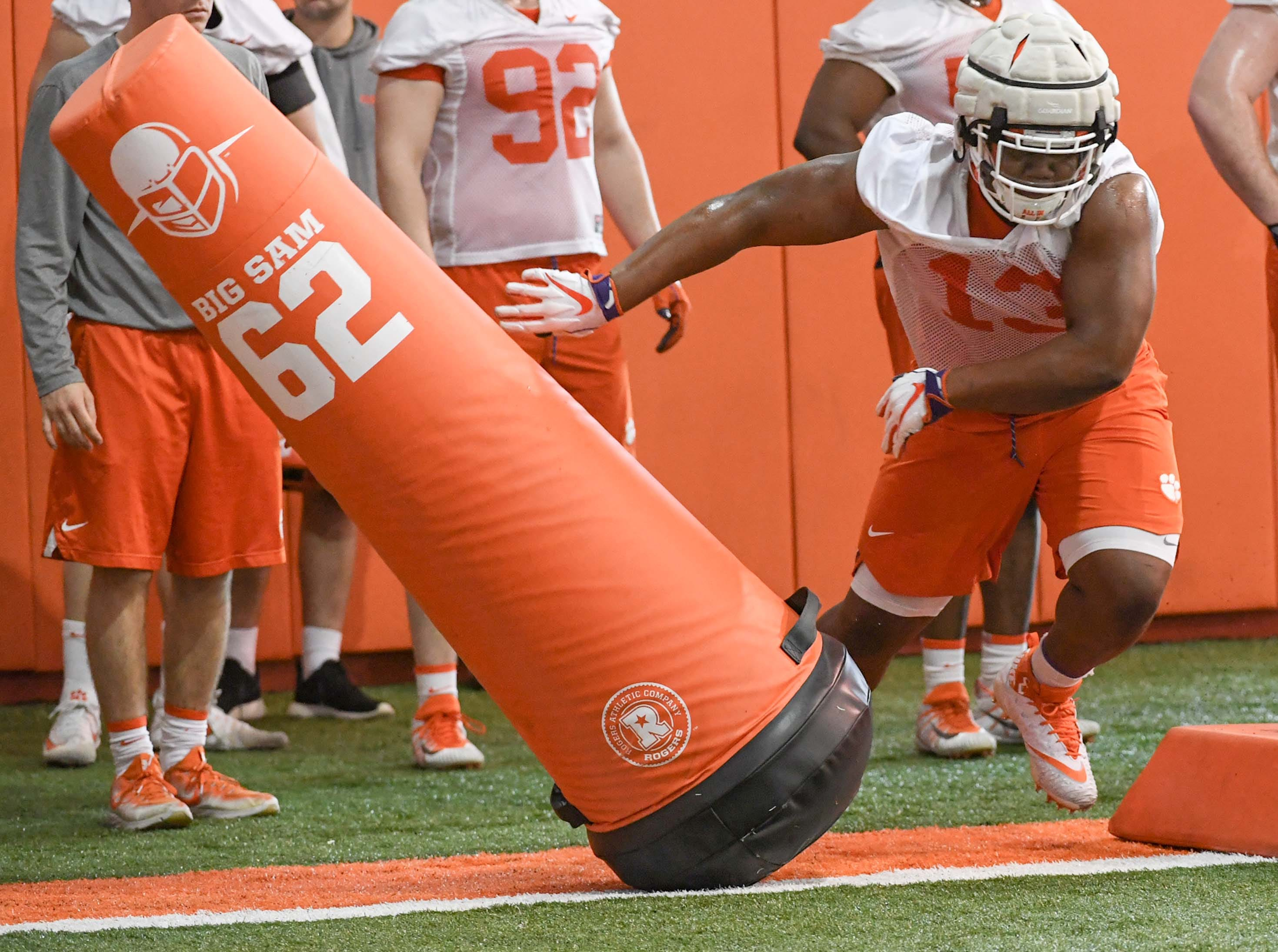 Clemson defensive lineman Tyler Davis(13) hits a blocking dummy during the first practice at the Clemson Indoor Practice Facility in Clemson Wednesday, February 27, 2019.