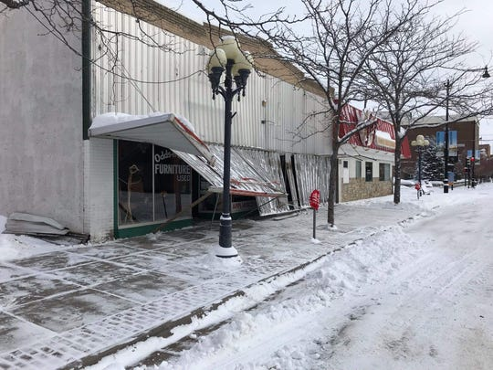 The awning of the store began collapsing on either Monday night or early Tuesday morning.