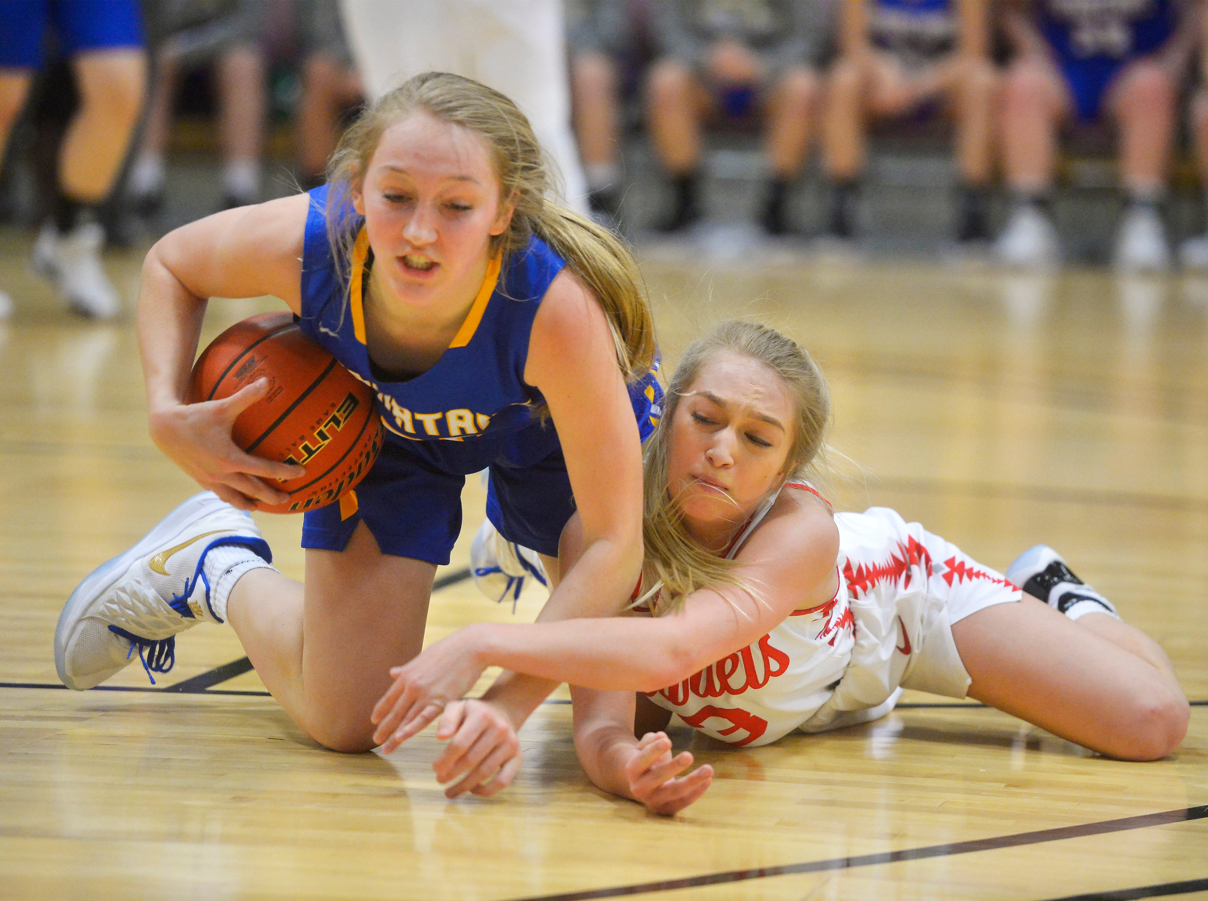 Scobey's Kortney Nelson and Arlee's Emily Fiddler battle for a loose ball during the Girls State C Basketball Tournament on Thursday in the Four Seasons Arena.